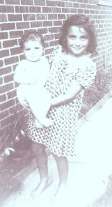 Rosemarie as a baby with her older sister